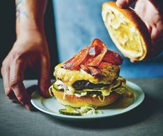 restaurant photography A no holds barred burger created by Tom Byng and Fred Smith from Byron restaurant. Its topped with seriously cheesy Welsh rarebit, a spicy mustard sauce and rashers of streaky bacon. Rarebit Sauce, Welsh Recipes, Burger Buns, Burger Recipes, Vegetarian Recipes, Food Styling, Food Photography, Lifestyle Photography, Gastronomia
