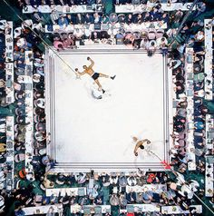 Ali knocks out Cleveland 'Big Cat' Williams in three rounds at the Houston Astrodome to defend his heavyweight title in November 1966. The bout drew a record indoor crowd of 35,460. Photo: Neil Leifer/SI