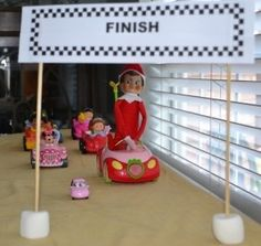 Elf on the shelf racing with friends. Seasons by Design specialty shop, 2605 Ford Drive, New Holstein, WI 53061.       920-898-9081 Seasonsbydesigngifts@yahoo.com  Follow us on Facebook