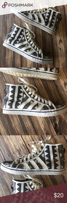 Adidas Tribal High Top Sneaker Black & White Sz 8 Adidas high top, black and white, tribal print sneaker. Well loved with lots of life left! These weren't worn very many times so have excellent shape. However, the white stained with dirt pretty easy. Size 8. Bundle and save! adidas Shoes Sneakers