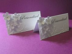 24 Personalised wedding table place cards with 3 flowers and embossed edge