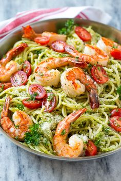 This recipe for shrimp pesto pasta is spaghetti tossed in a flavorful pesto sauce, then topped with sauteed shrimp and tomatoes.