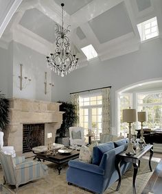 Bow window and imposing old stone fireplace