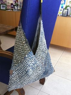 A multimended bag of indigo mosquito netting, kaya just keeps on going. With time and patience, nearly all things can be mended. blue and white shop tokyo Boro, Triangle Bag, Japanese Bag, Visible Mending, Linen Bag, Fabric Bags, Day Bag, Black Tote Bag, Cloth Bags