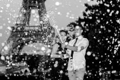 Champagne shower in front of the Eiffel Tower. Engagement photo session in Paris
