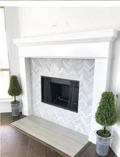 Love the marble herringbone tile design of this fireplace! Love the marble herringbone tile design of this fireplace! Fireplace Tile Surround, Fireplace Redo, Farmhouse Fireplace, Fireplace Remodel, Fireplace Surrounds, Fireplace Ideas, Fireplace Backsplash, Tall Fireplace, Tiles For Fireplace