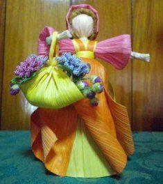 Corn husk doll basket of flowers