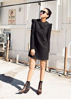 Black mini dress + leg of mutton sleeves - The 10 Bloggers With the Most Stylish Boot Collections via @WhoWhatWear