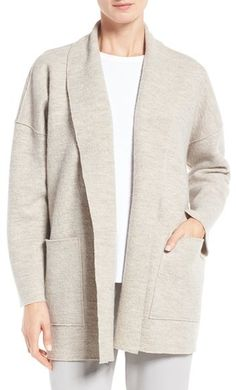 Raw-edge seaming brings a casually deconstructed look to a funnel-neck coat crafted from cozy boiled wool. Eileen Fisher Boiled Wool Funnel Neck Coat