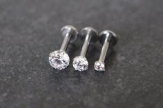 Product Information Product Type: Straight Barbell in Surgical Stainless Steel Gauge Size: 16 Gauge Wearable Barbell Length: Charm Dimensions: Triple Crystal Star Cartilage, Tragus, Helix Earring Piercing Ear Stud Barbell Crystal 16 Gauge Piercing Tongue Web, Smile Piercing, Piercing Labret, Labret Studs, Triple Helix Piercing, Helix Piercing Jewelry, Conch Jewelry, Forward Helix Piercing, Silver Jewelry