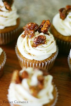 pecan pie pumpkin cupcakes with pecan pie filling and cream cheese frosting