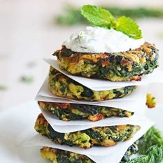 Zucchini, Feta, and Spinach Fritters with Garlic Tzatziki- Great for appetizers or a light snack, and a fantastic way to sneak in some veggies!