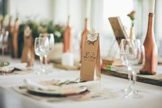 My husband and i mixed our interests into our wedding...  His coffee roastery has the raw wood look and feel and thats why we gave our guests coffee as gifts  combined with my world of fashion we used very old pattern paper as our placemats with some lovely lace details