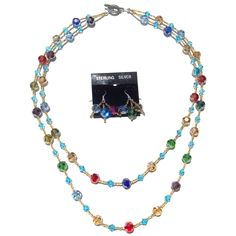 Bright, vibrant summer colors! Quality cut glass crystals in round and bicone, in a rainbow of colors, with gold foil lined seed beads. Double strand, but very light!