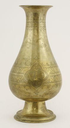 A brass altar vase, the neck engraved with a band of flowerheads in arcaded borders, the body with two quatrefoil reserves engraved 'WP' and with a crown within a band of stylised foliage Sold for £2000 on 15th September 2015