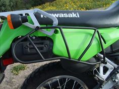 Side utility racks. Protect plastics from tip overs and soft cases from exhaust.