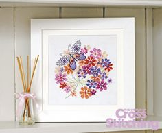 Cross stitch pattern – colourful flowers and butterfly, stunning design in the new issue 201 of The World of Cross Stitching