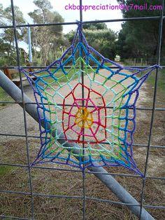 Rainbow Spider Web yarn Bomb
