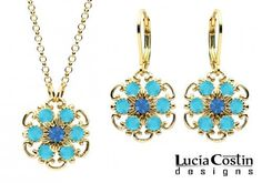 Lucia Costin Jewelry Set: Pendant and Earrings Made in 24K Yellow Gold over .925 Sterling Silver with Blue and Turquoise Swarovski Crystals and Twisted Line Accents, Crafted with 6 Petal Flowers Lucia Costin. $105.00. Handmade in USA unique jewelry set. Lucia Costin delicate set of jewelry. Enriched with sapphire and turquoise Swarovski crystals. Style takes wings in this lovely jewelry set that have a graceful flower shape. Dangle ornaments accented with flora...