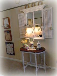 Stained top, painted legs table. Old window into mirror with shutters.