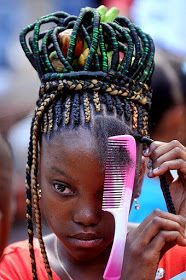 Once a year, on May 21st, the Afro Colombians commemorating the abolition of slavery in Columbia in 1851. As part of the celebration, there is a contest of Afro Hairstyles that honor the African culture