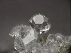 Leucite, KAlSi2O6, Caspar quarry, Ettringer Bellerberg, Ettringen, Eifel, Germany. Fov 3 mm. Copyright: Stephan Wolfsried