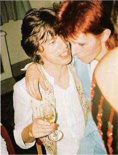 Mick Jagger and David Bowie.