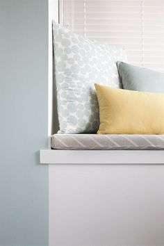 The final reveal! Soft blue, yellow and natural cushions team up with duck-egg blue on a feature wall. Available in New Zealand through Guthrie Bowron stores.