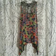 High Low Angie Tank Top Flowy floral Angie tank top with lace shoulders and an uneven hem. Angie Tops Tank Tops