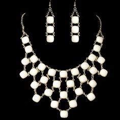 "Add a sophisticated twist to your everyday outfit with this fashionable jewelry set. The details of this chic necklace and earrings set feature glamorous white acrylic stone encrusted in gold plating. Perfect accessory for your everyday wear or to compliment your special occasion attire.Necklace - 17""Extender - 2 3/4""Drop - 2 3/4""Earrings - 2 1/2"" x 1/2"""