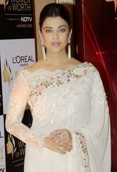 Aishwarya Rai: Latest Saree Blouse Designs sure to Amaze You'. In Pic: OMG in Broad Boat Neck Blouse In Lace With Uncut Edges, w/ floral Tarun Tahiliani saree; earrings gorg too (in Indian Saree Fashion Off Shoulder Saree Blouse, Net Saree Blouse, Lace Saree, Saree Blouse Long Sleeve, Boat Neck Saree Blouse, White Saree, Netted Blouse Designs, Fancy Blouse Designs, Saree Jacket Designs Latest