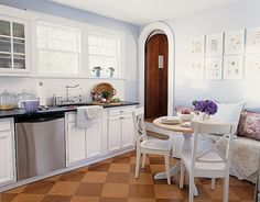 I've always loved this kitchen and am so glad I found the pictures online. That door kills me.