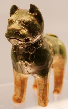 Etched and glazed pottery dog. 25-220 AD. (Shanghai Museum.)