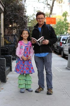 I spotted these two from a block away. They were walking away from me, so I chased them down to see if I could photograph the girl for a microfashion post. When I finally caught up to them, however, I noticed that the father was reading to her as they walked.