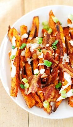 Spiced up sweet potato fries, baked to perfection and topped with chopped bacon! JuliasAlbum.com #gluten_free_food #appetizers #snacks #french_fries