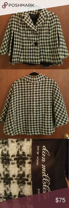 Vintage Houndstooth Cape Coat by Dan Millstein Dan Millstein was a New York coat and suit maker of the 1950s and 1960s. Marilyn Monroe got married to Joe DiMaggio in a suit by Millstein. Calvin Klein got his start at Millstein in 1962 as a sketch artist.  Missing the top button but I think it works better without it. I didn't even notice when I got this 3 years ago from an old opera singer. Thick Houndstooth fabric.  Roughly 20-21 inches long and 17-18 inches from armpit to armpit. Would…
