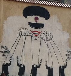 Egypt: Military Pulls the Strings (Tahrir Graffitti) Photograph by Juan Cole of graffiti, Tahrir Square, mid-May 2012, showing the Supreme Council of the Armed Forces as the puppeteer of Egyptian politics. (Since erased in a government campaign to clear graffiti).