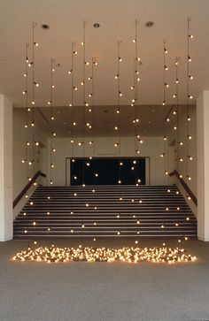 Dress up a plain room for a #wedding #ceremony or reception with hanging lights! Pictured: Installation by Felix Gonzalez-Torres at the Whitney Museum of American Art. Photograph by Marc Domage