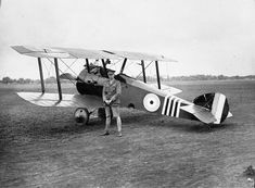 """William George """"Billy"""" Barker VC, DSO & Bar, MC & Two Bars (3 November 1894 – 12 March 1930) with his Sopwith Camel, his favorite aircraft."""