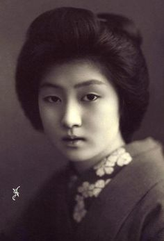 Hawaryu worked as a geisha in Japan at the turn of the century and is pictured posing in a distinctive kimono with cherry blossom collar