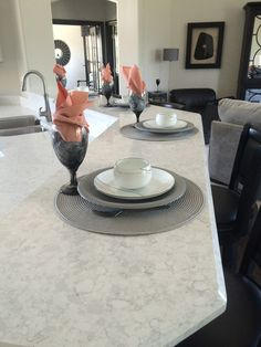 Not ready for to go bold? Pale colors like these pink napkins add a nice inviting touch without being too over-the-top. Zodiaq® Stratus White pictured here in The Breckenridge by J Anthony Homes & Designs, LLC