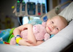 Say hi to Azalee, a St. Jude patient who loves cuddling with her adorable pink pig.