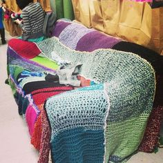 Even the couch had its own sweater.  | 20 Things You'll Find At A Craft Camp For Grown-Ups