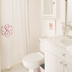 Monogram a plain white shower curtain for a girl's bathroom. What a simple idea & easy way to add something extra to a plain curtain. From Southern Living's creative children's baths.