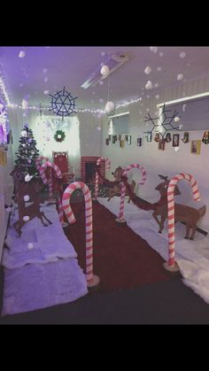 Santa's grotto. Walkway, reindeer, snow, candy canes.