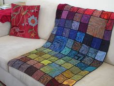 I have been wanting to make some sort of a patched quilt like this (it is knitted squares) but not quite so rainbow-y.
