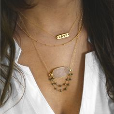 koshikira kk jewelry with a collection of stacking rings, layer look necklaces, druzy bracelets and gemstone earrings