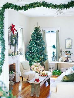 Grand Entrance:   Hang a simple green garland around a doorway to create a frame around the Christmas scene ahead. To attach the garland to the molding, wrap florist's wire around the garland and tie to small nails spaced every foot or two.