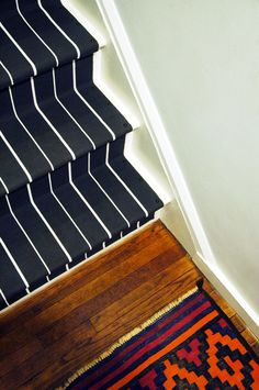DIY: Stair Runner   Dollar Store Rug Pads Underneath, Finishing Nails On  Side.