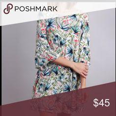 8f1c1bbf5d Plus Tunic Dress Plus Curve size tropical print tunic dress. Dimensional  fluted sleeve.